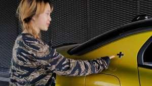 领克03+侧身车尾处加号,彰显了驾驶员追求更高性能的内心